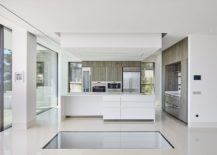 Sleek-and-polished-contemporary-kitchen-in-white-217x155