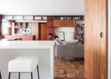 Sliding-wooden-panels-and-smart-lighting-create-a-dynamic-living-environment-217x155