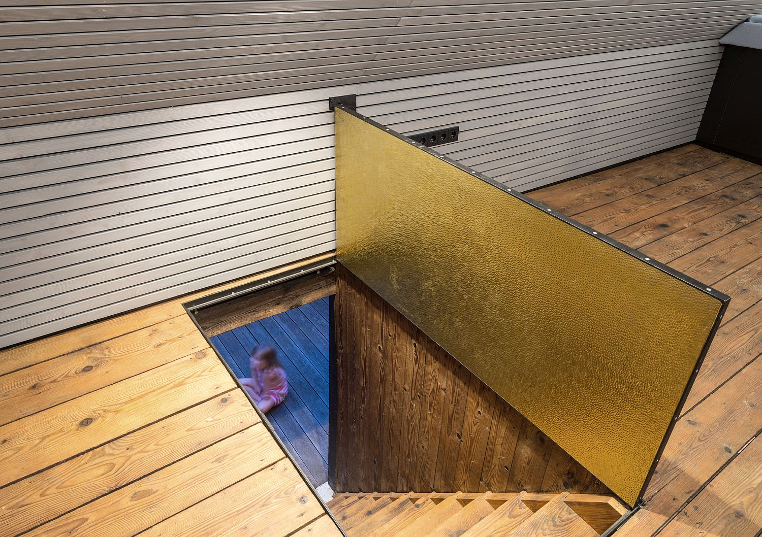Small-and-cozy-attic-getaway-with-a-brass-trapdoor