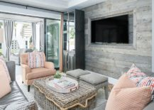 Small-and-stylish-beach-style-living-room-with-accent-wooden-wall-and-pastel-hues-217x155