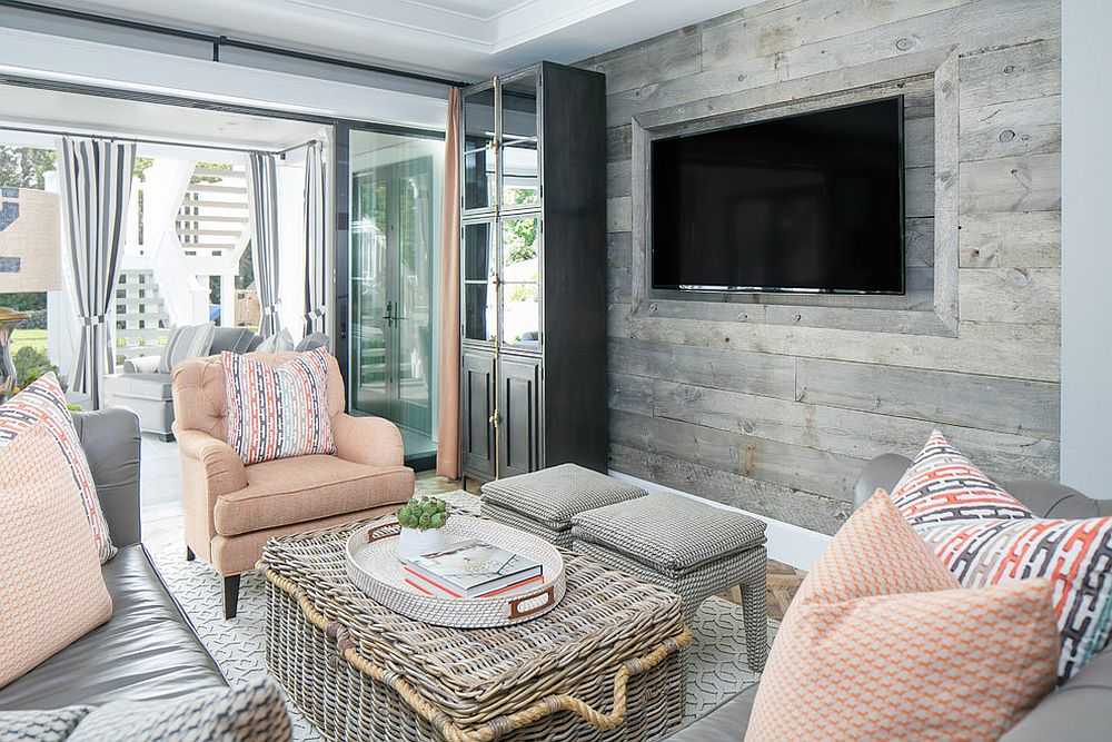 Small and stylish beach style living room with accent wooden wall and pastel hues