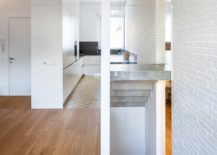 Small-corner-kitchen-in-white-with-wooden-flooring-217x155