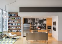 Small-modern-kitchen-with-stainless-steel-island-on-wheels-next-to-a-lovely-reading-nook-217x155