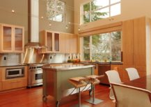 Smart-kitchen-island-on-wheels-with-stainless-steel-countertop-217x155