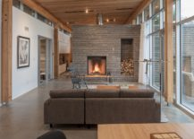 Stone-fireplace-becomes-the-focal-point-of-the-stunning-living-room-with-ocean-views-217x155