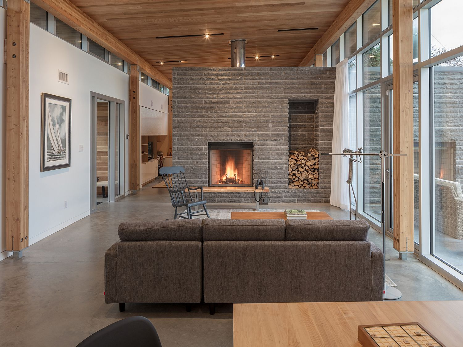 Stone fireplace becomes the focal point of the stunning living room with ocean views