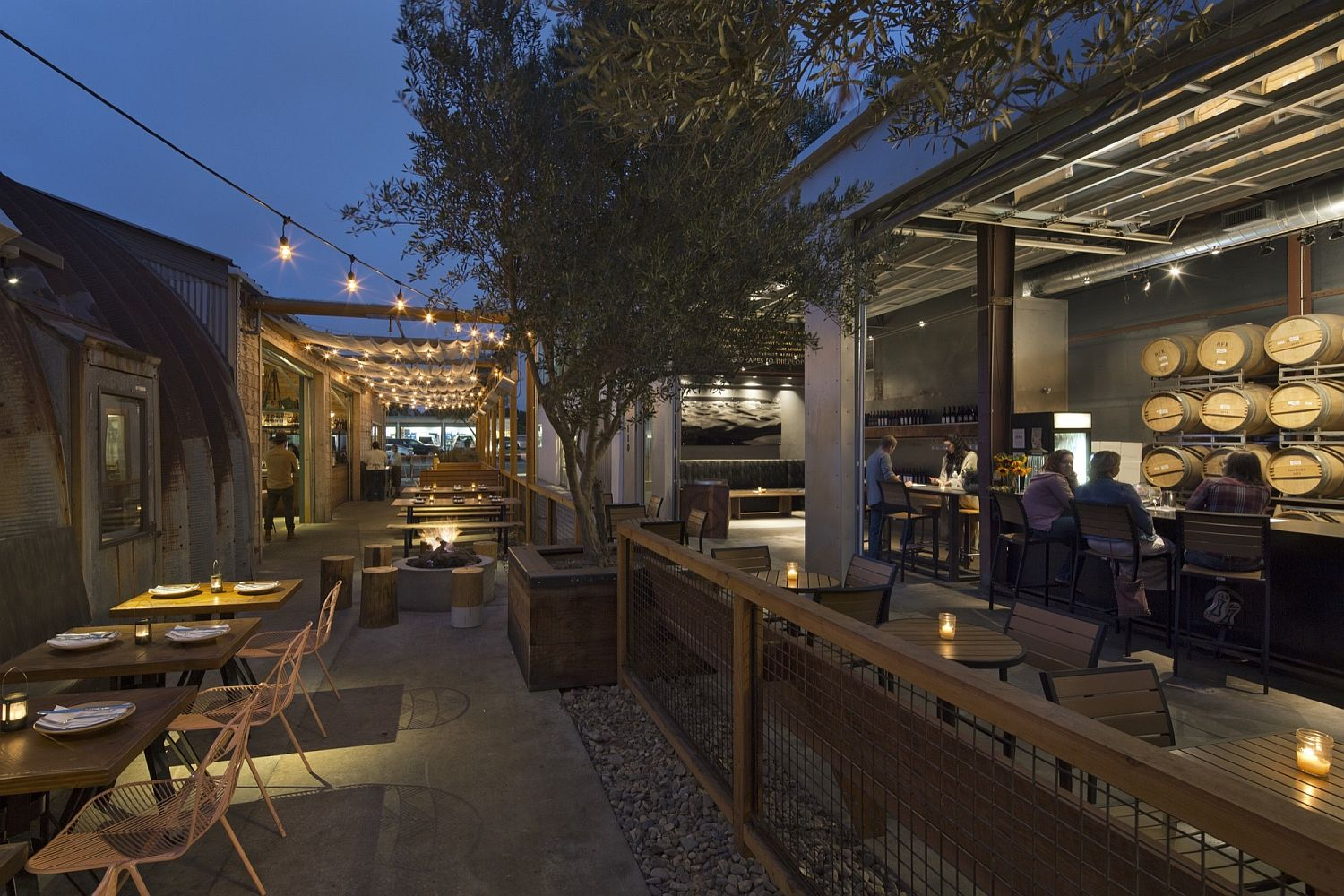String lighting transforms the outdoor dining area and bar into a hip zone