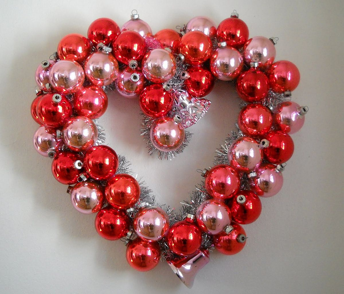 Turn those old Christmas ornaments into a glittering Valentine's Day wreath
