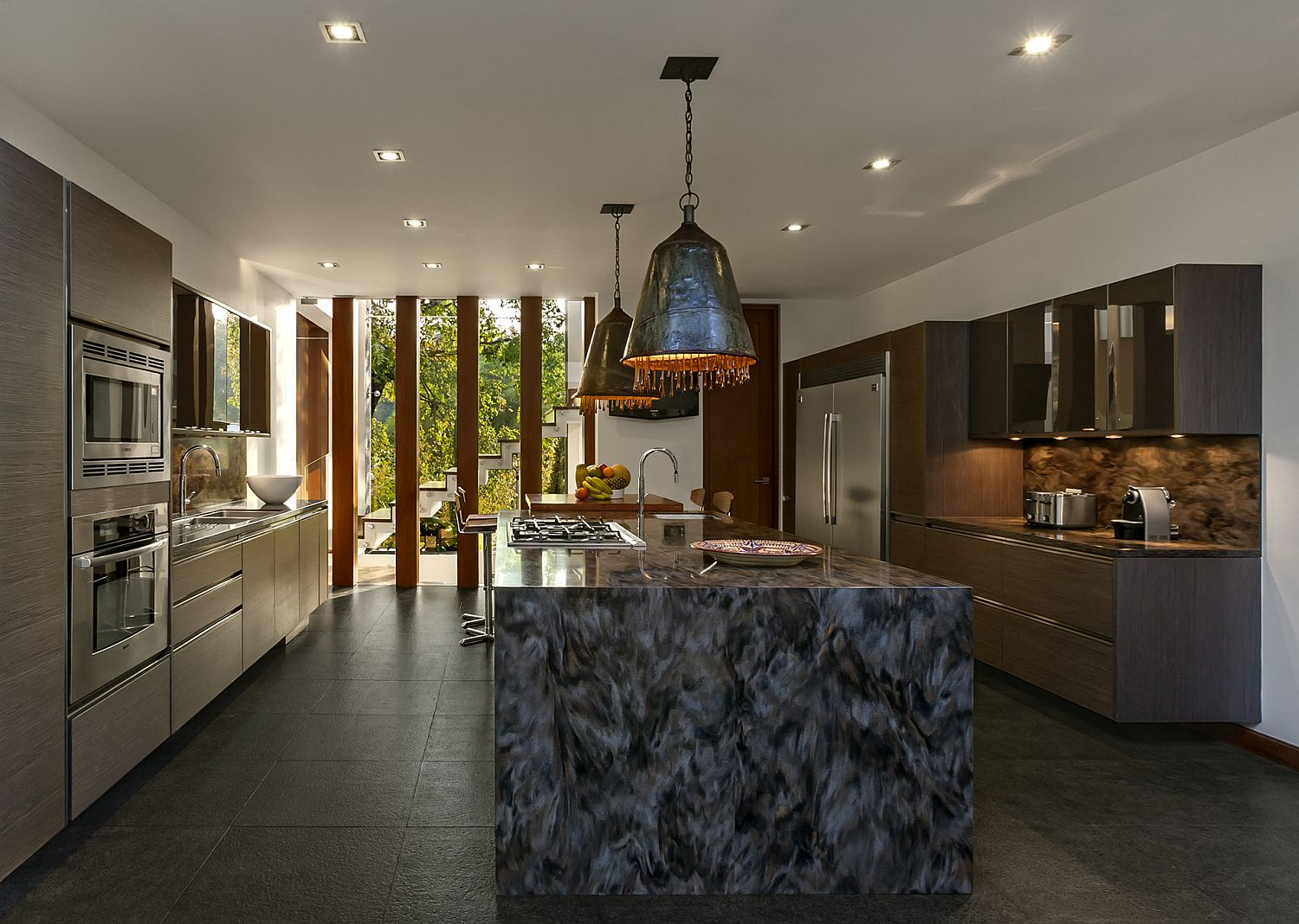 Unique-pendants-with-metallic-glint-and-custom-kitchen-island-in-stone