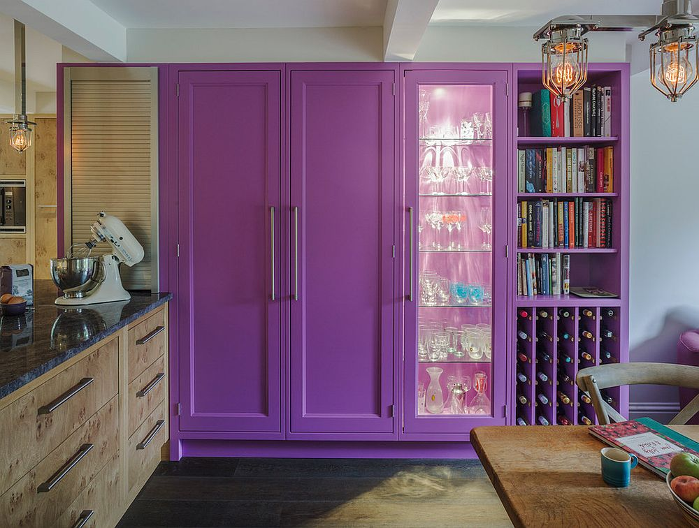 Violet cabinetry in the kitchen along with wine rack steals the spotlight here