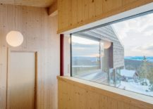 Warm-wooden-tones-inside-the-cabin-combine-minimalism-with-relaxing-elegance-217x155