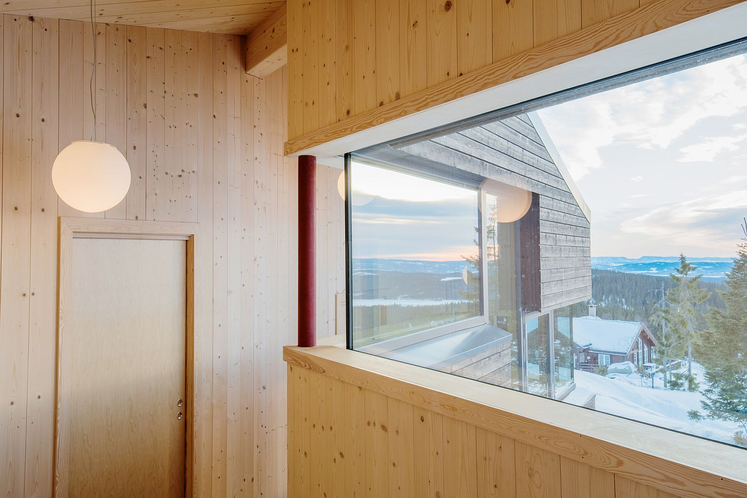 Warm wooden tones inside the cabin combine minimalism with relaxing elegance