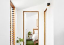 White-and-wood-along-with-the-green-of-the-flooring-creates-a-refreshing-living-environment-217x155