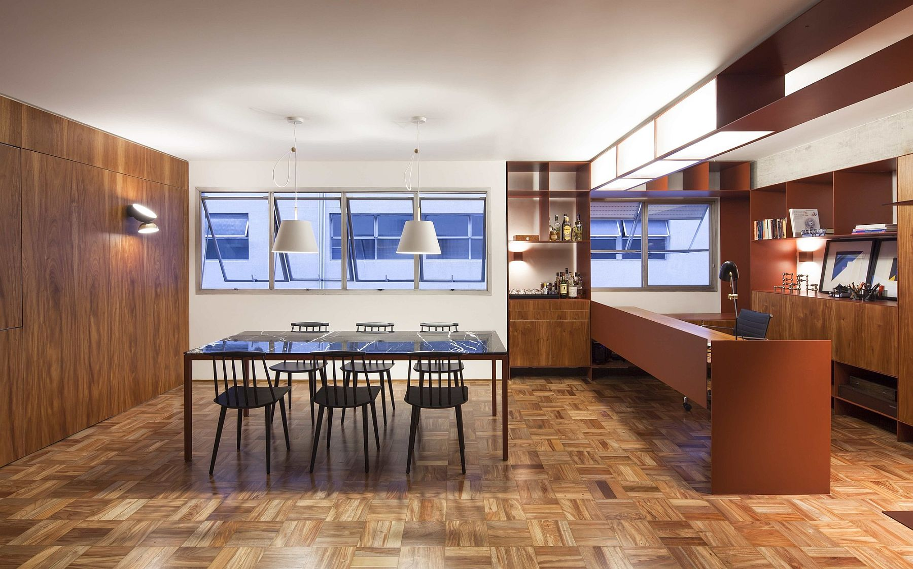 Wood and metal home office is the showstopper inside the apartment