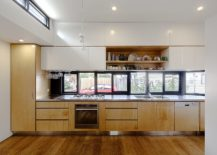 Wood-and-white-modern-kitchen-with-window-above-the-kitchen-counter-217x155