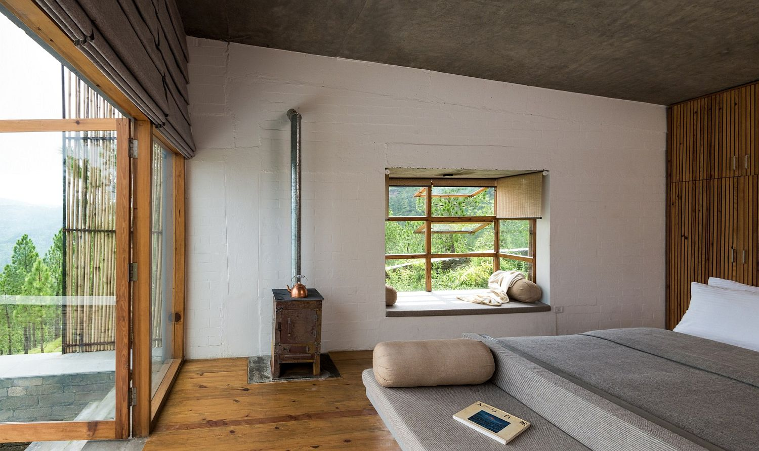 Wood, rustic finsihes and bamboo give the bedroom of the Himalayan hotel a cozy appeal