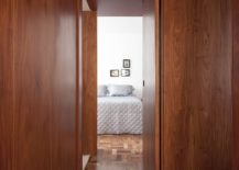 Wooden-panels-and-unique-floor-give-the-apartment-cozy-bright-appeal-217x155