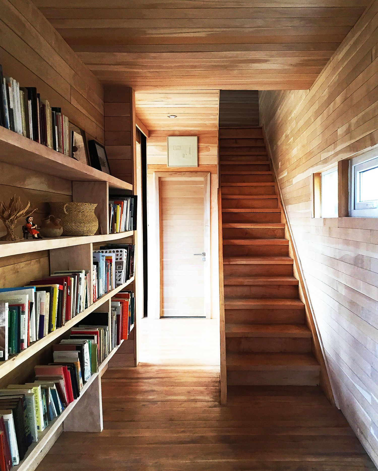 Bookshelf in the hallway is a space-savvy addition