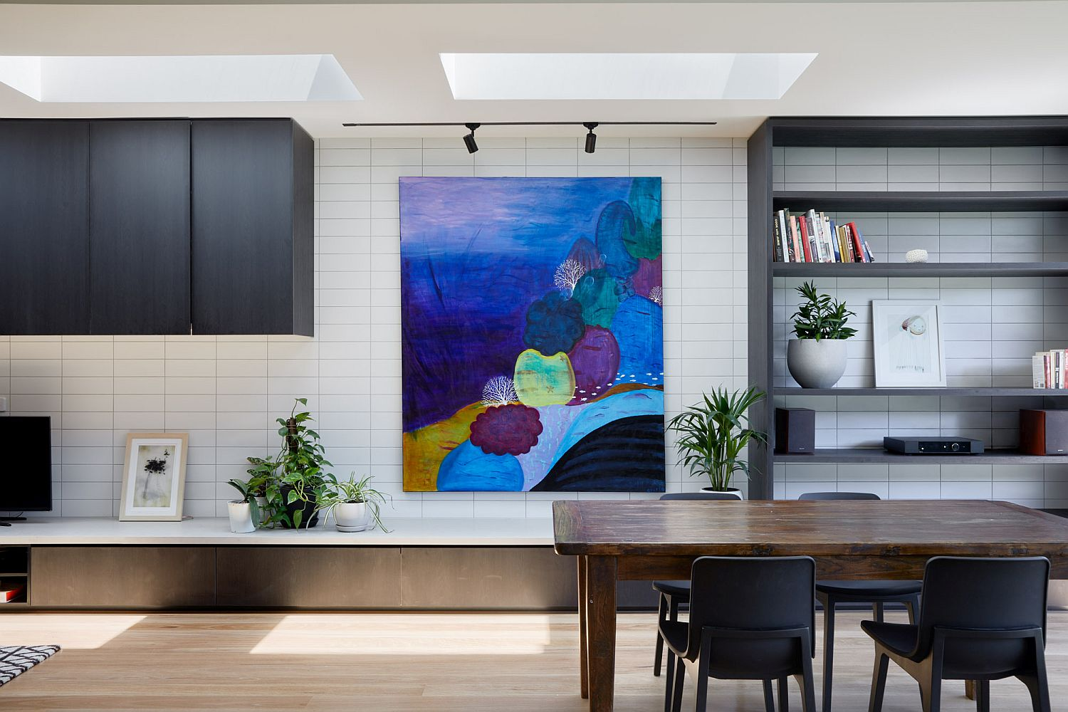 Bright wall art brings color to the neutral interior