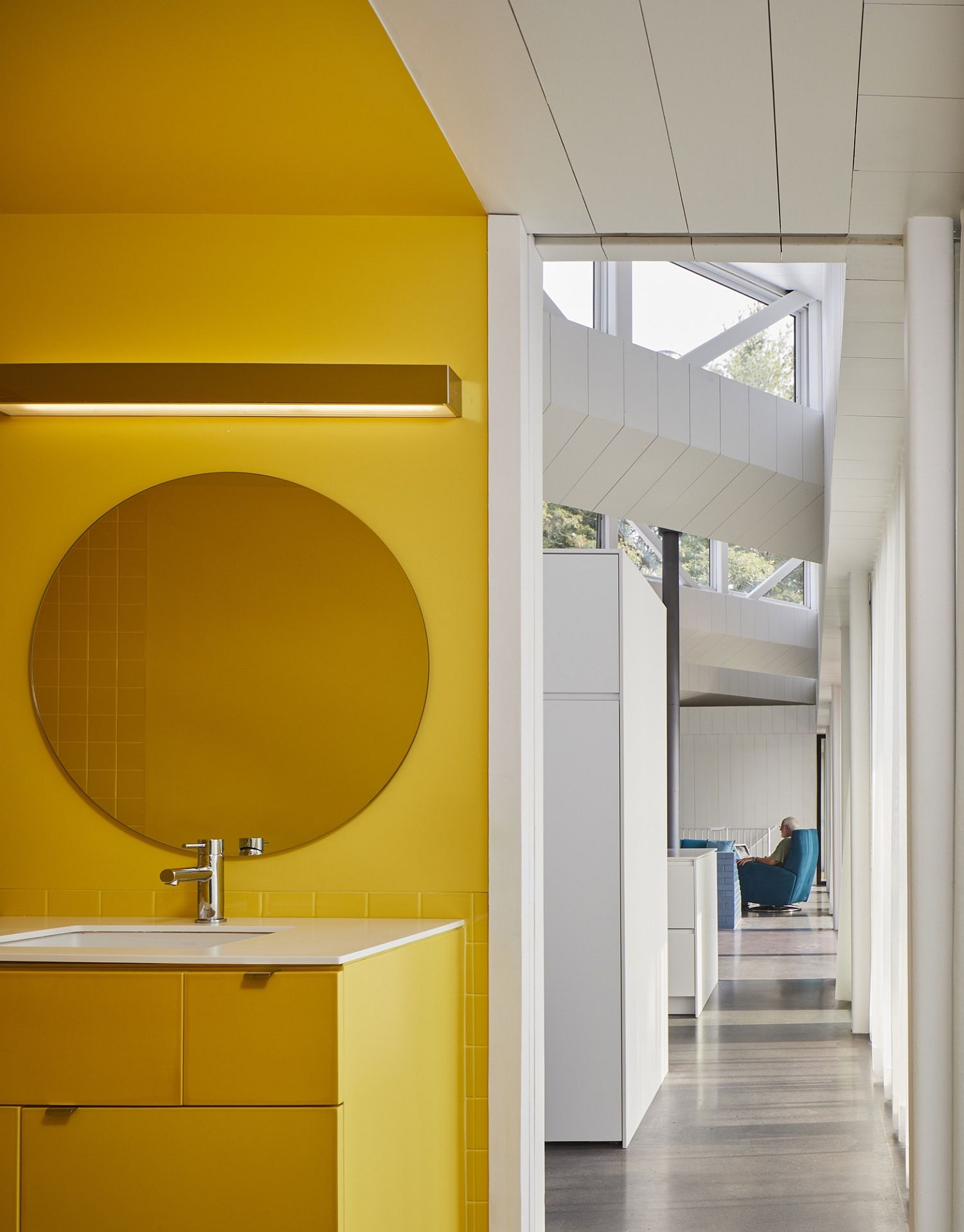 Bright yellow walls bring lively elegance to the interior
