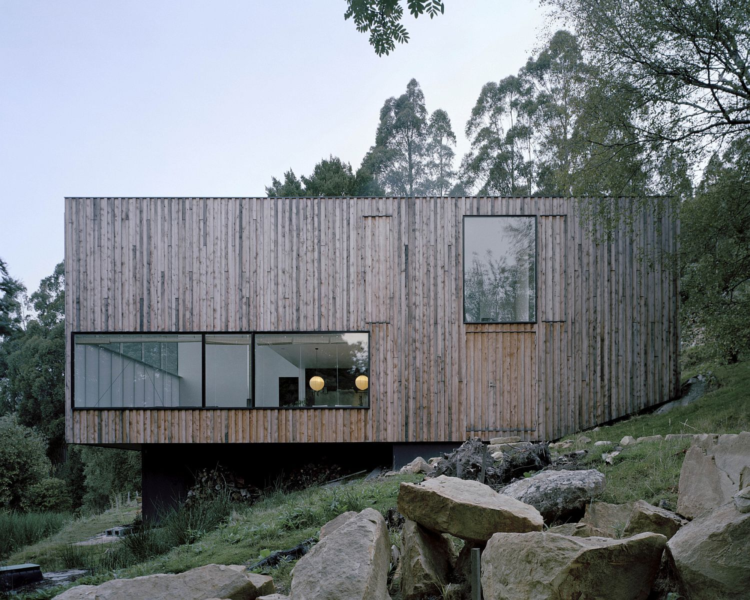 Cantilevered design of the home adapts to the slope of the lot