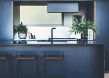 Dark-blue-gives-the-kitchen-a-sophisticated-and-contemporary-appeal-217x155