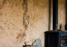 Earthen-walls-and-rustic-finishes-give-the-interior-an-elegant-appeal-217x155