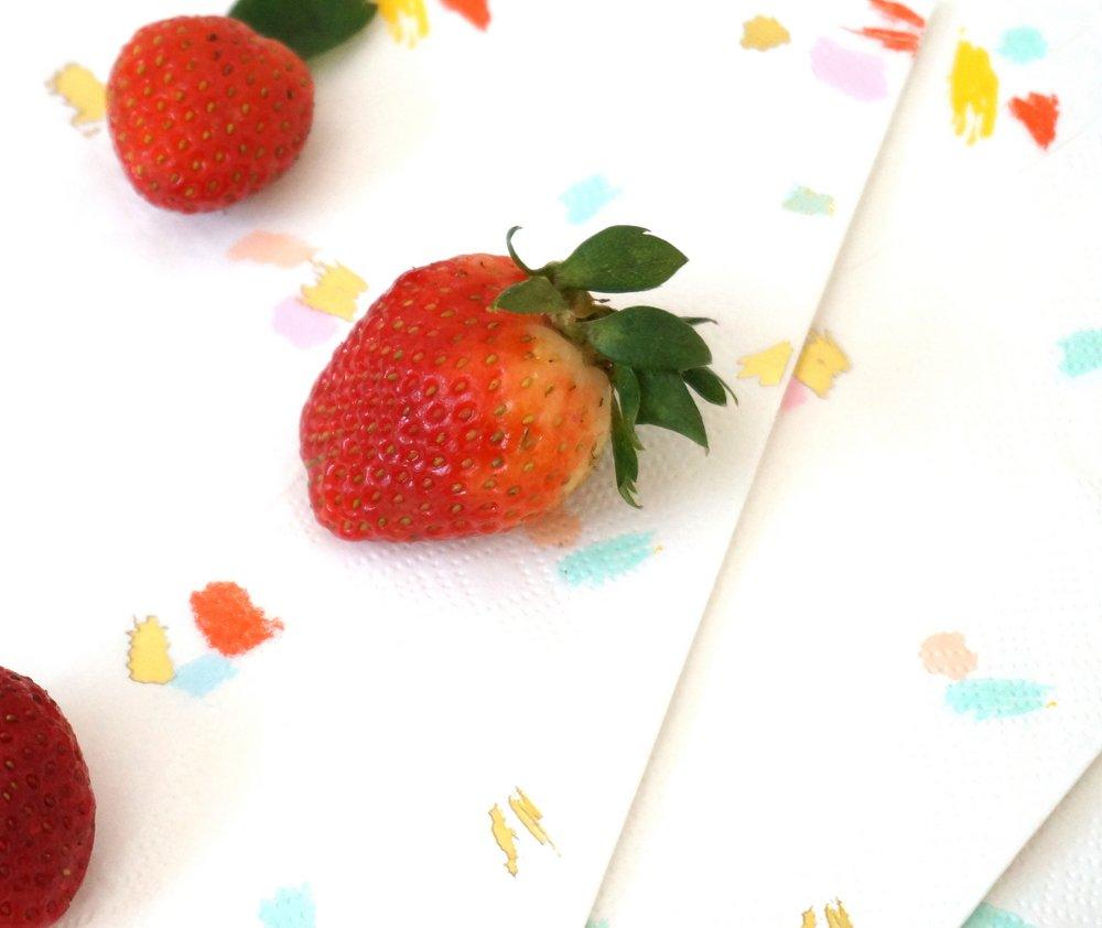 Fresh strawberries on napkins by Sugar & Cloth