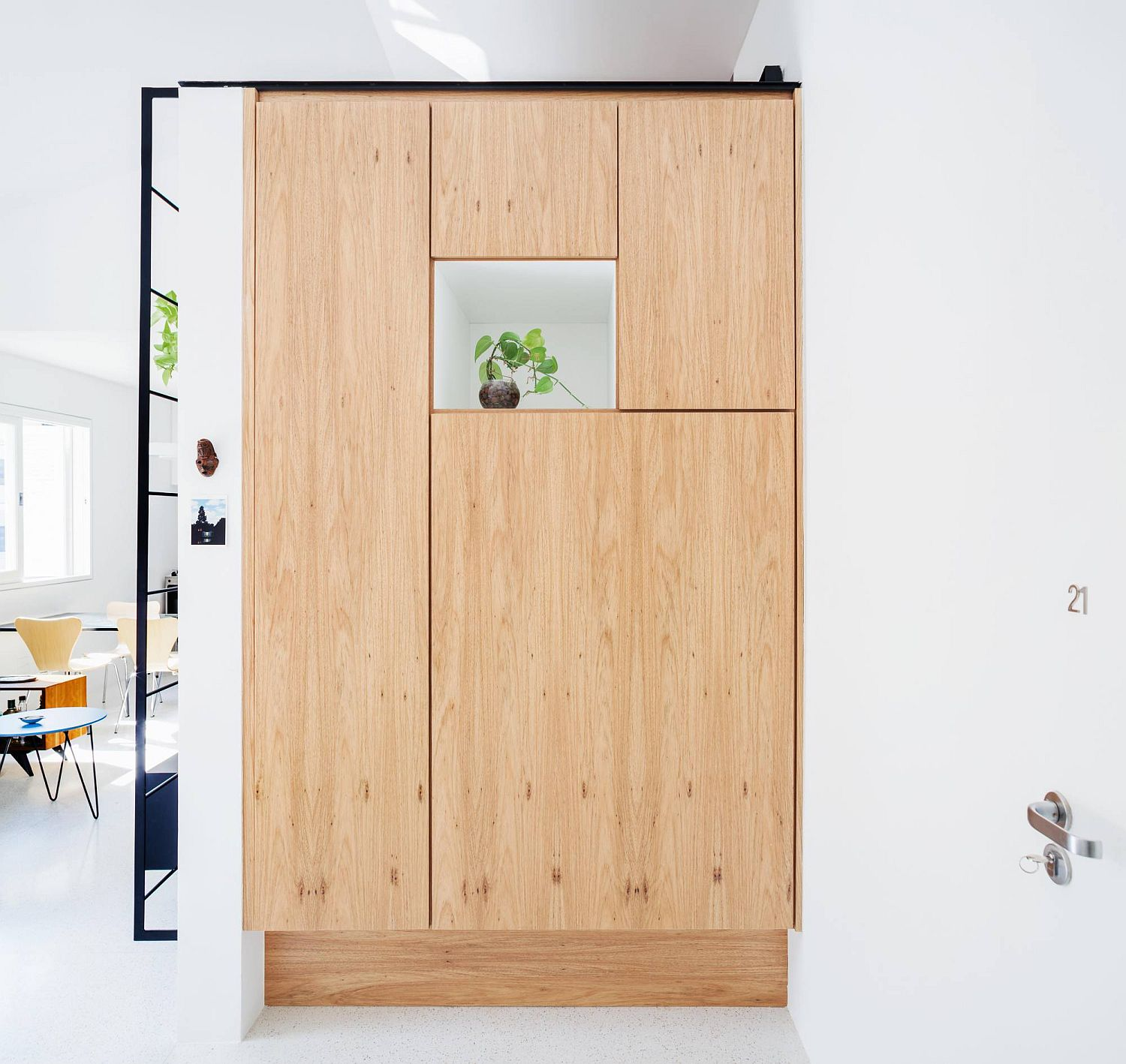 Giant wooden pantry that is neatly tucked behind wooden doors