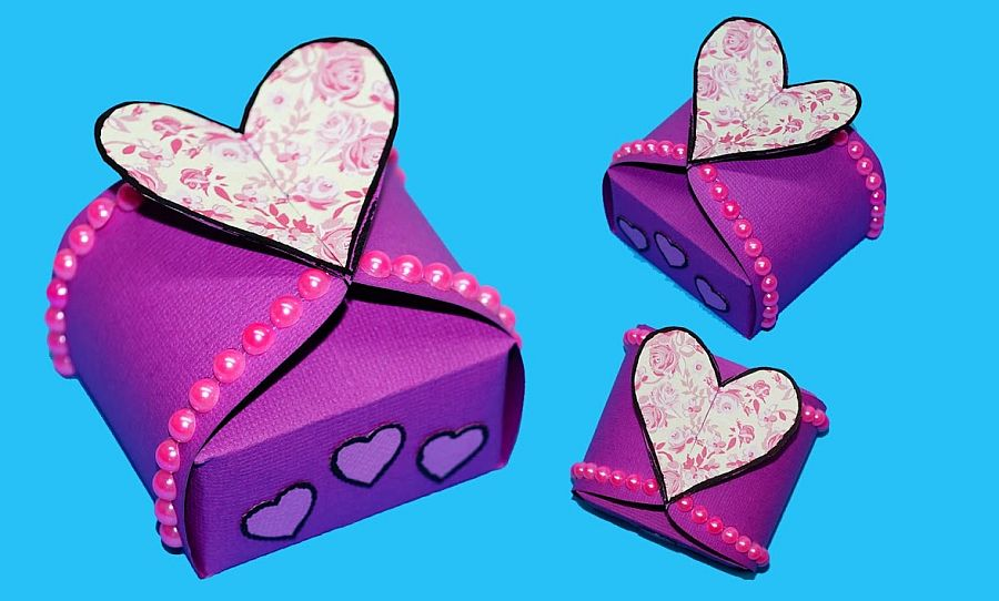 Gift box sealed with hearts in Purple