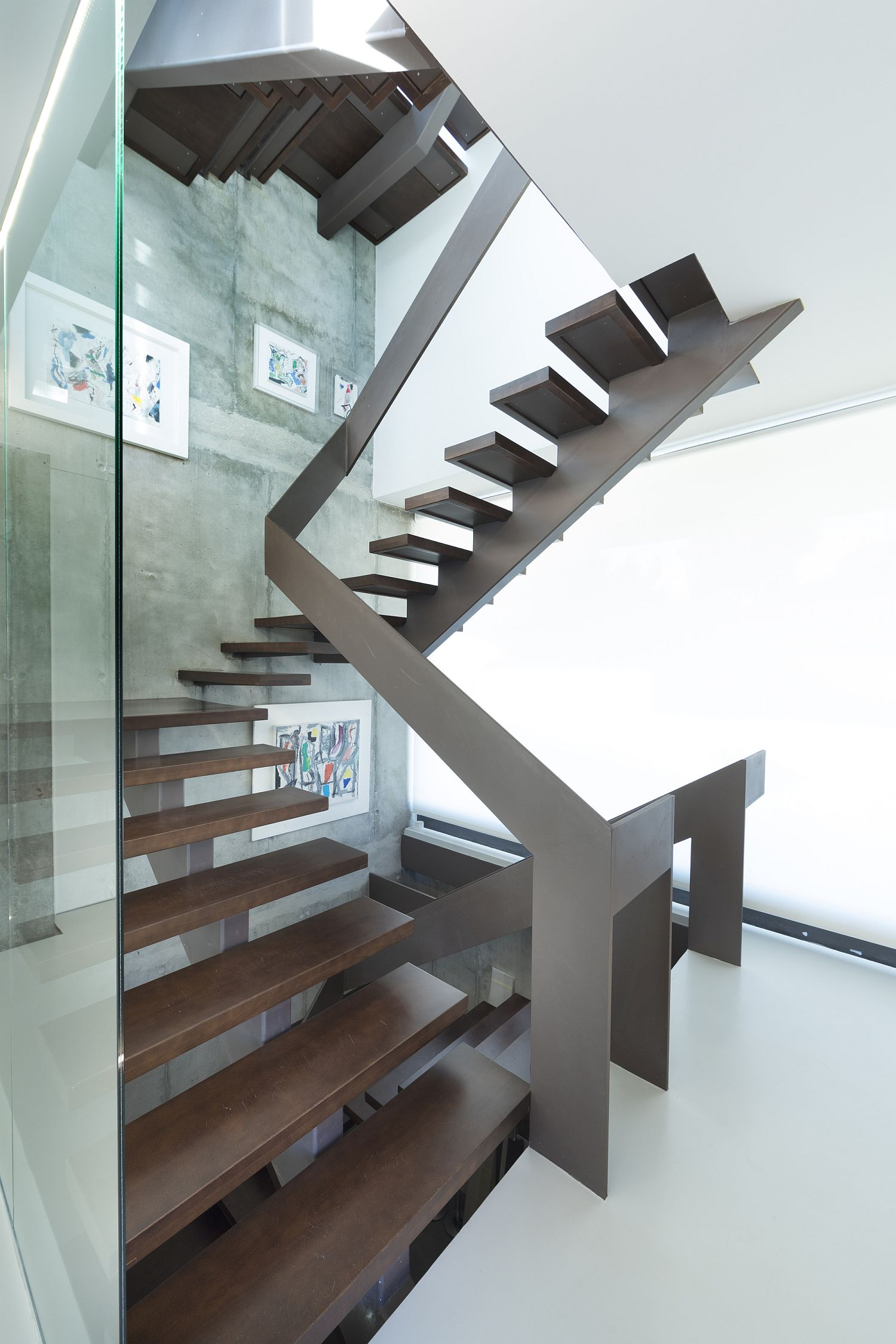 Glass and wood sculptural staircase for the modern home