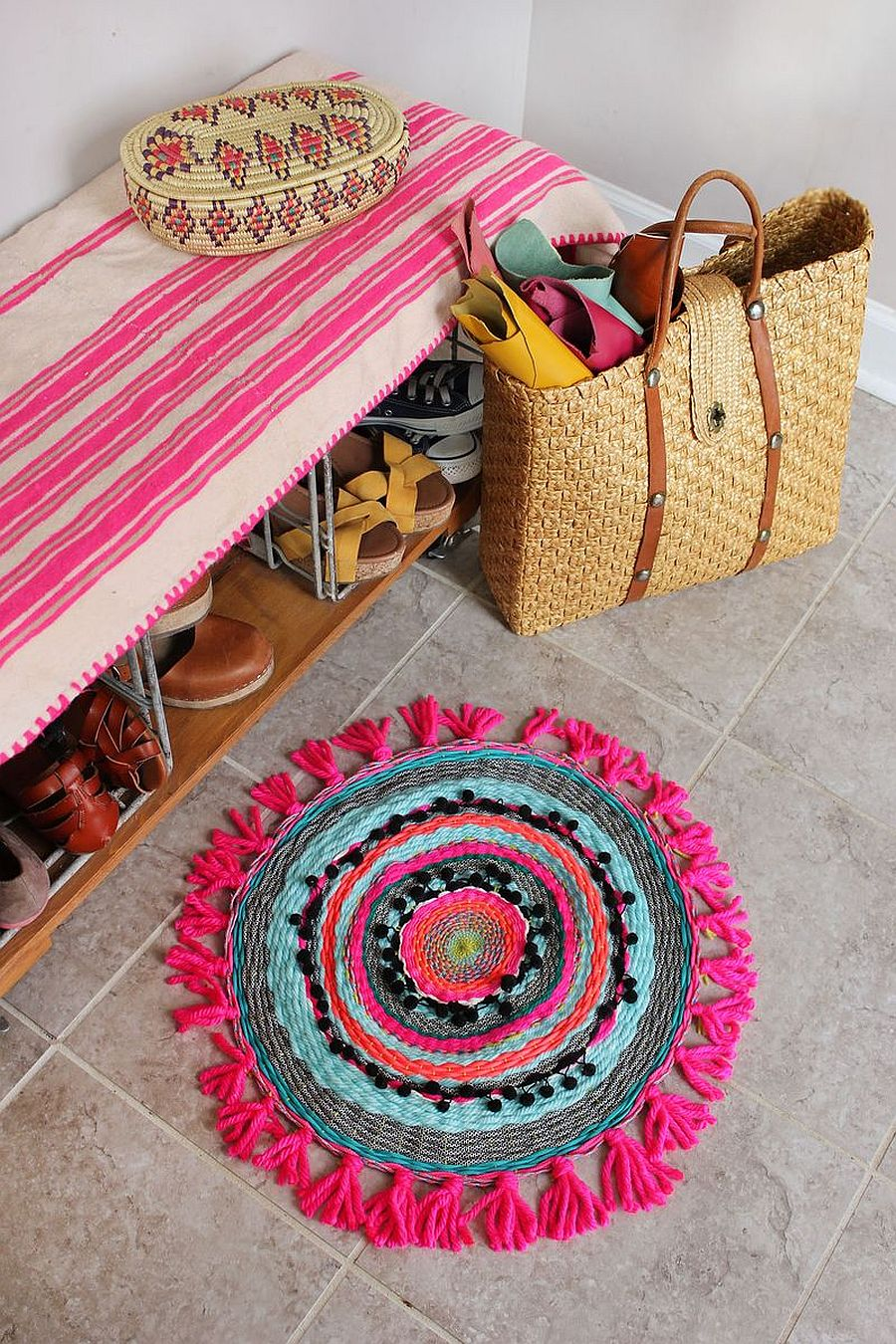 Homemade woven circle mat with pink panache