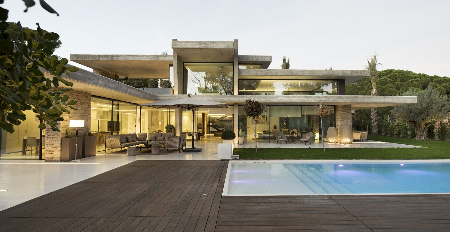 Horizontal concrete planes give the home a cool structure