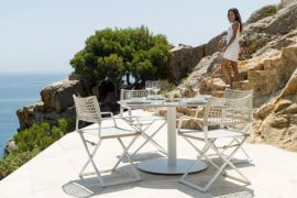 Glamorous Outdoor Table and Weather-Resistant Chairs Create a Trendy Hangout