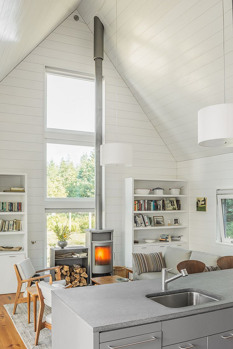 Living area with gable roof and an interior in white