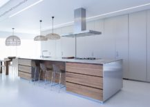 Lovely-use-of-large-pendants-for-kitchen-and-dining-area-217x155