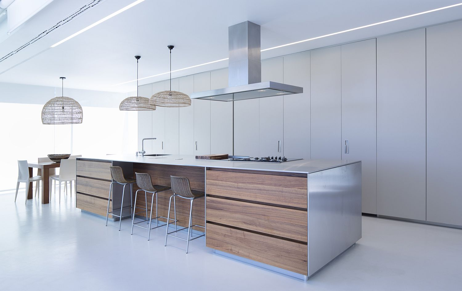 Lovely use of large pendants for kitchen and dining area