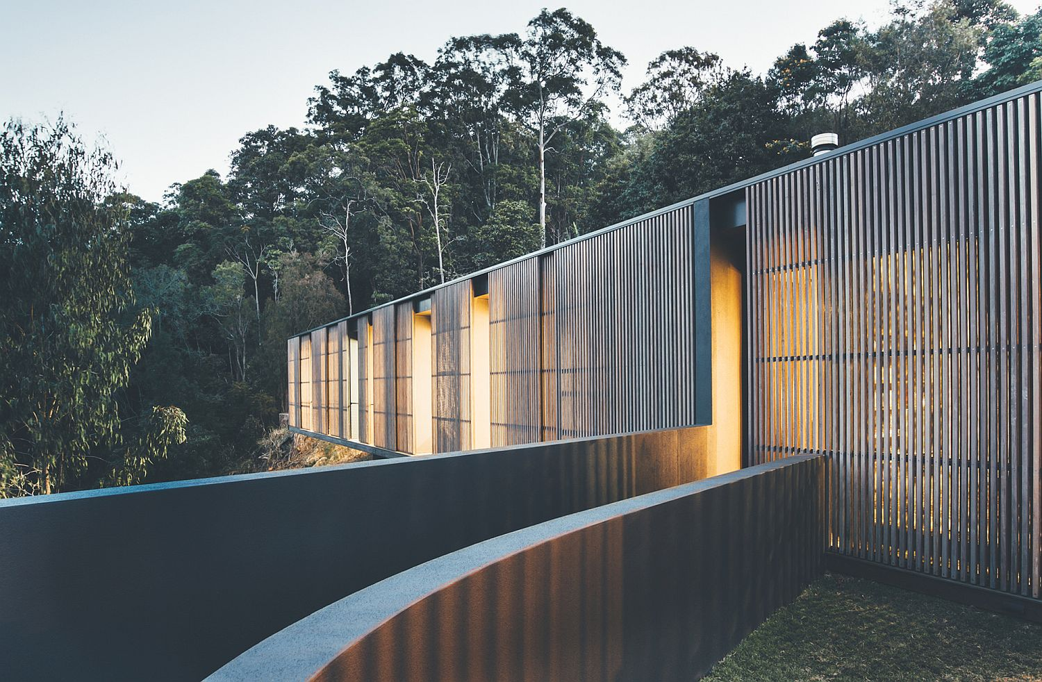 Lovely use of slats provides a balance between ventilation and privacy