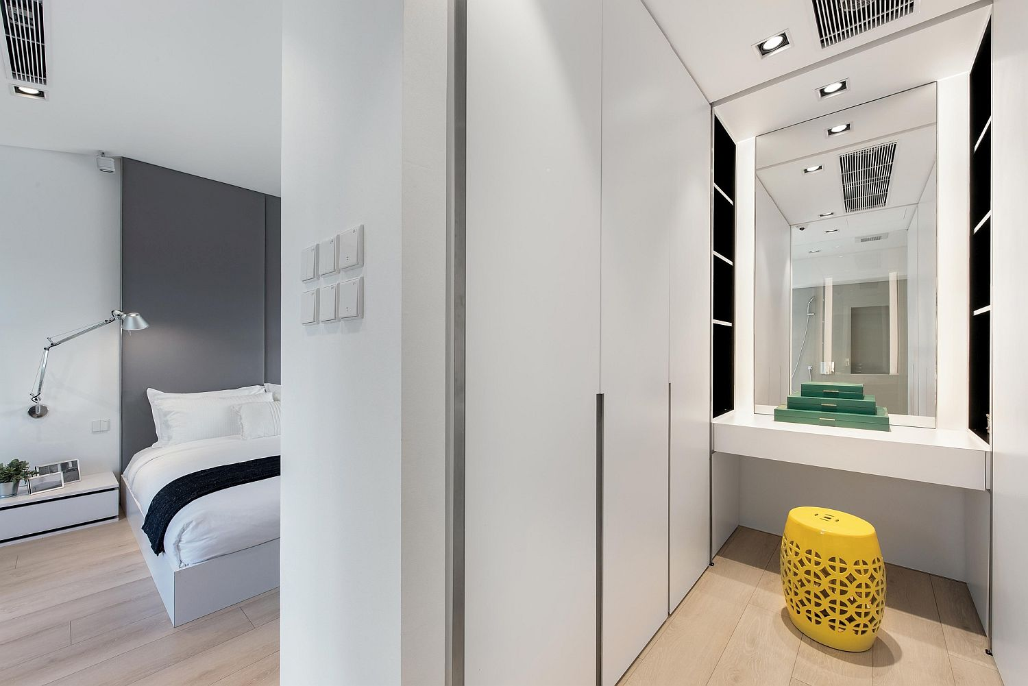 Master-bedroom-and-bathroom-in-white-with-wooden-flooring