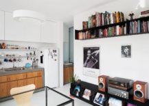 Metallic-blcak-bookshelf-and-entertainment-unit-in-the-living-room-217x155