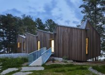 Metallic-roof-and-wooden-exterior-of-lakeside-home-in-Canada-217x155