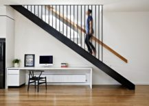 Metallic-staircase-connecting-the-lower-level-with-the-new-first-floor-extension-217x155