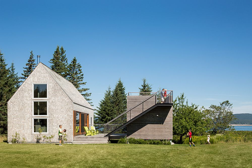 Modern structure next to 100 year old farmhouse with ocean views