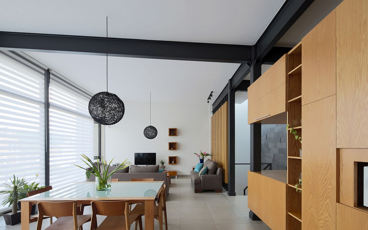 Open-plan-living-area-of-Casa-Milán-that-is-lit-up-in-natural-light