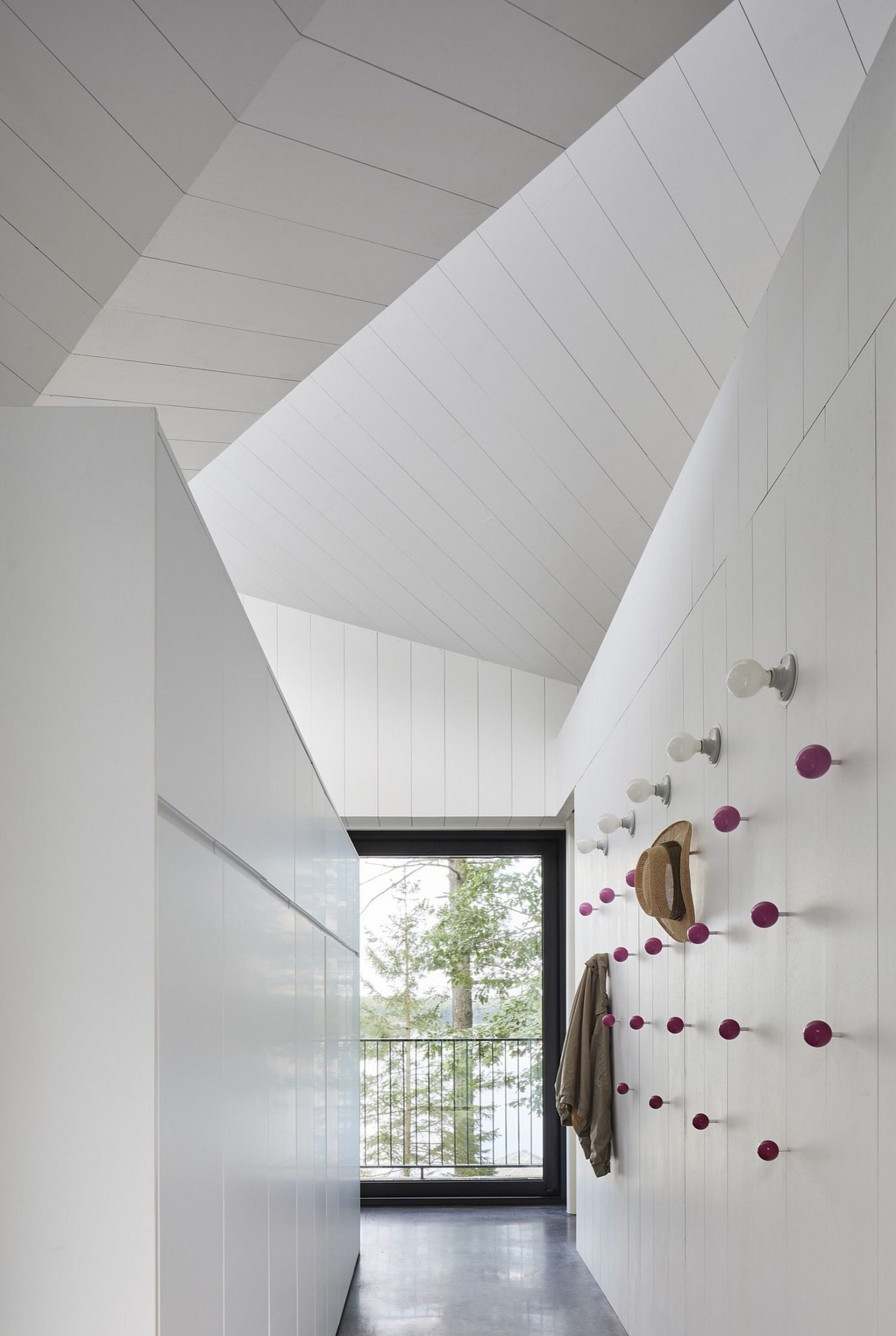 Simple and minimal coat hanger system in the hallway