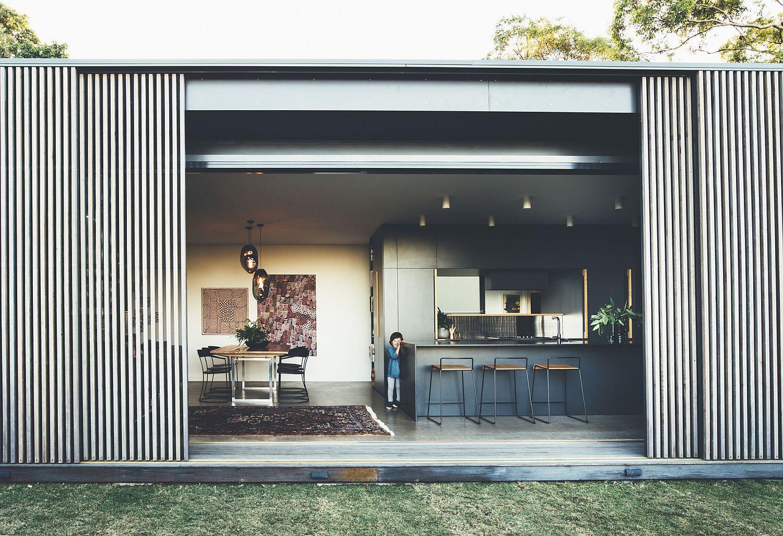 Smart sliding hardwood screens create a flexible living area