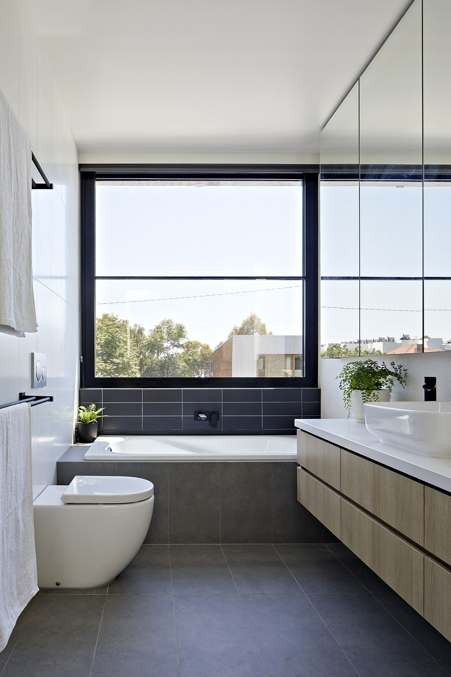 Spacious and elegant contemporary bathroom in gray and white