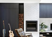 Stacked-firewood-and-brickwall-section-on-the-lower-level-of-the-house-217x155