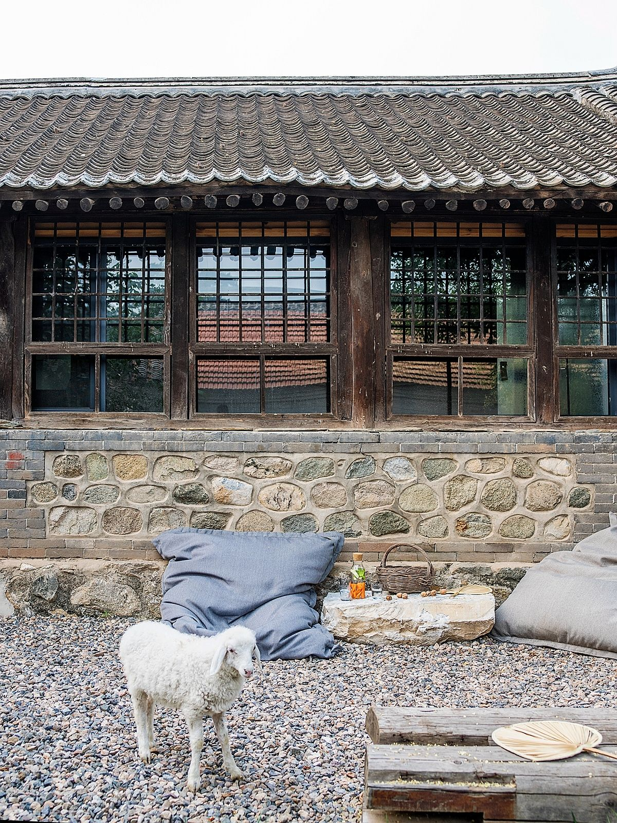Stone walls, terracotta tiles and earthen walls of the rustic Chinese home