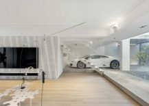 Transparent-garage-of-the-Hong-Kong-showcases-proudly-the-homeowners-car-217x155